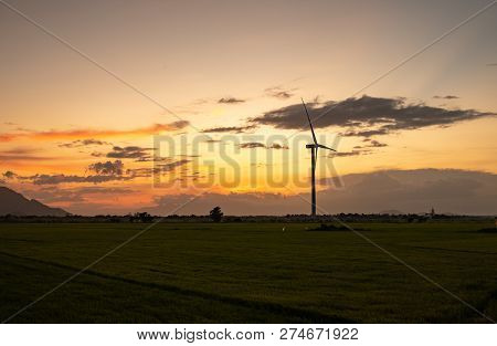 Wind Turbine Farm Or Windmill On Golden Sunset Sky In Summer Day. High-quality Stock Photo Image Of