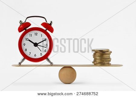 Clock And Money On Scales - Balance Between Time And Money, Time Is Money Concept