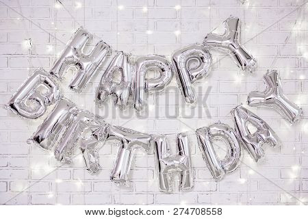 Birthday Party Decoration - Happy Birthday Letters Air Balloons Over White Brick Wall With Lights