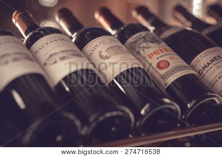 Moscow, Russia - Dec 2018: Mood shot of grand red wine Chateau Margaux 1995 and other wines in rack