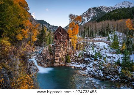 Historic Wooden Powerhouse Called The Crystal Mill In Colorado With Colorful Autumn Colors. It Is Lo