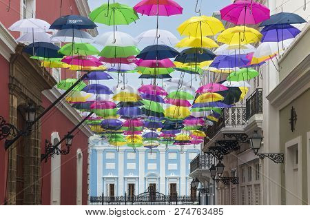 Umbrellas Above San Juan Streets And Mansion
