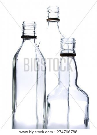 Empty glass wine bottles on a white background