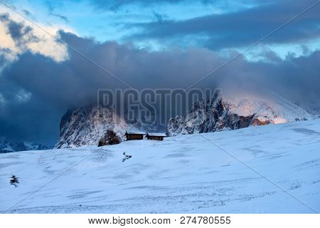 Small cottage in Dolomite mountains in Alpe di Siusil, Italy in winter.