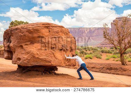 Girl Pushing Big Stone Hard, Impossible And Useless Concept