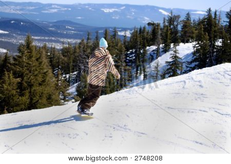 Snowboarder About To Drop Down The Mountain