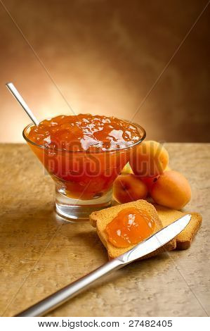 apricot jam with toast and knife