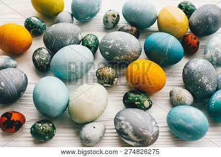 Happy Easter Pattern. Stylish Easter Eggs On White Wooden Background. Modern Easter Eggs Painted Wit