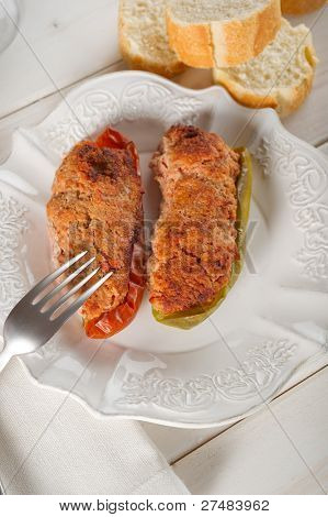 stuffer pepper on dish with fork and slice bread
