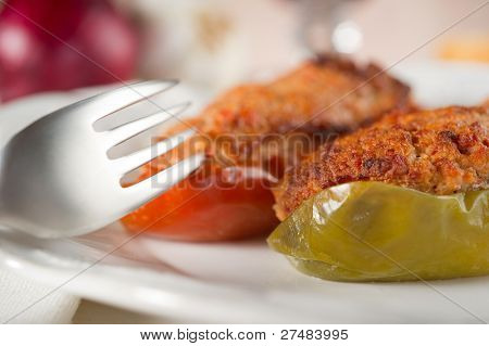 stuffer pepper on dish with fork close up