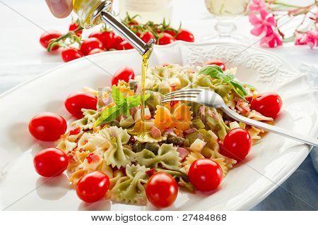 olive oil over pasta salad