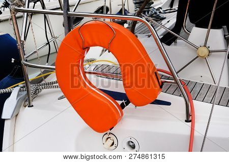 Modern  Life Vest On Board Yacht. Rescue On Water In Summer Concept. Horseshoe Rescue System.