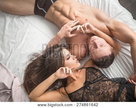 Couple In Love In Bed. Sensual Awakening Loving Couple.