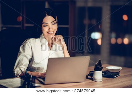 Young Businesswoman Working In Office At Night. Girl Working On Computer At Night In Dark Office. Mo