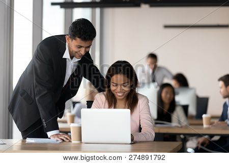 Cheerful Diverse Coworkers Working Together In Coworking Area