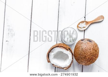 Coconut Oil In Cosmetic Concept On White Desk Top View