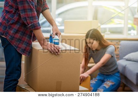 Closeup Asian Young Couple Packing The Big Cardboard Box For Moving In New House, Moving And House H