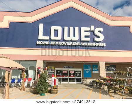 Entrance To Lowe's Hardware Store Under Cloud Blue Sky