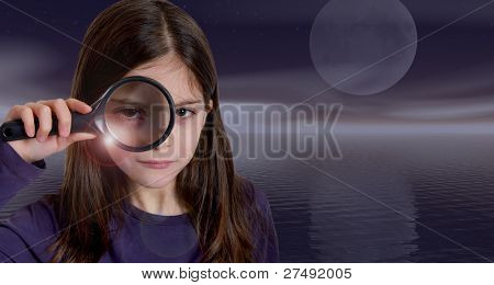 Girl holding magnifying glass on moonlight with lens flare effect