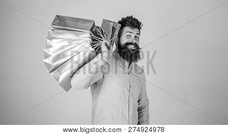 Hipster On Winking Face Shopping. Guy Shopping On Sales Season, Carries Bunch Of Bags On Shoulder. M