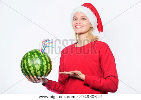 Winter vitamin fruit ration. Strengthen immunity concept. Girl wear santa hat drink watermelon vitamin cocktail straw. Woman enjoy vitamin drink. Rich vitamin ration concept. Detox after christmas poster