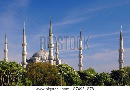 Istanbul, Turkey - May 1, 2012: Blue Mosque With Its Six Minarets And Chestnut Trees Against The Blu
