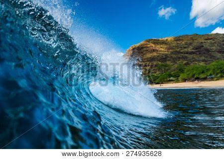 Blue Hawaiian wave of the surf spot named Tracks located on the West Coast of Oahu, Hawaii, USA