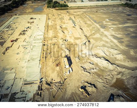 Aerial View Machinery Working With Footing And Foundation Concrete Forming Of Construction Site