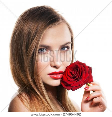 Beautiful young woman with red rose on white.