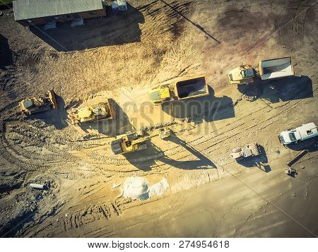 Filtered Tone Top View Construction Equipment And Machine At Work In Texas, America