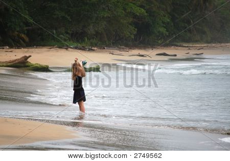 Young Woman Enjoying The Beach