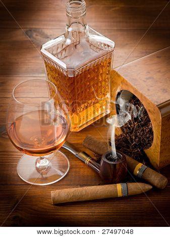 smoking pipe, tobacco, cuban cigar and liquor