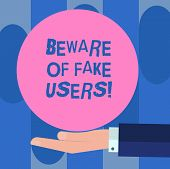 Handwriting text Beware Of Fake Users. Concept meaning Be aware of safety and danger in online communications Hu analysis Hand in Suit Offering Blank Solid Color Circle for Logo Posters. poster