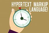 Writing note showing Hyper Text Markup Language. Business photo showcasing Standard languages for the creation of websites Hu analysis Hand Holding Stop Watch Timer with Start Stop Button. poster