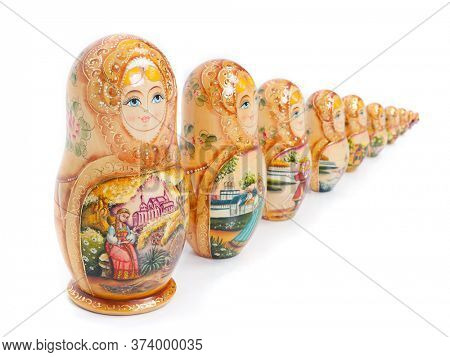 Group of Russian nesting dolls (also named as Matrioshka) isolated over white background. Wooden doll souvenir.