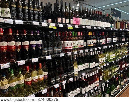 Rows Of Shelves With Bottles - Different Brands German Made White And Red Wines In Shop. Konz, Germa