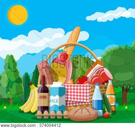 Wicker Picnic Basket Full Of Products. Wine, Sausage, Bacon And Cheese, Apple, Tomato, Cucumber, Sal