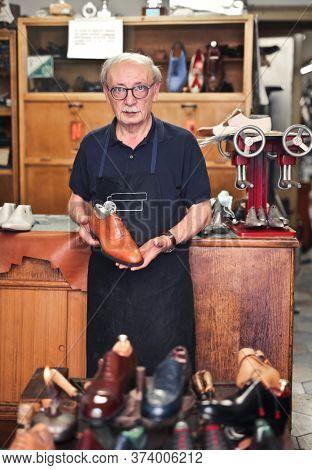 shoemaker craftsman in his workshop
