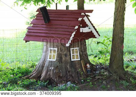 A Beautiful Old Rustic Stump For Elf And Gnome Hut House In A Country Field