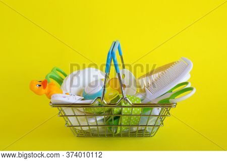 Shopping Basket With Baby Care Items - Scissors, Hairbrushes, Pacifiers, Thermometer, Cotton Pads, P