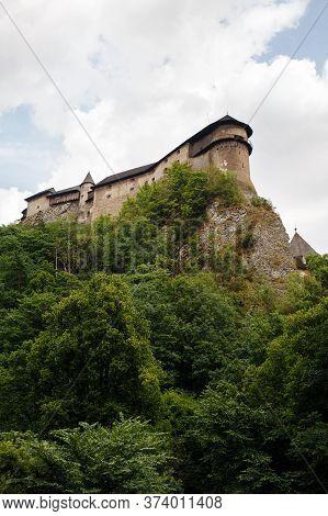 View On Orava Castle On A High Rock Above Orava River In The Village Of Oravsky Podzamok In Slovakia