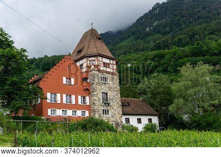 Vaduz, Fl / Liechtenstein - 16 June 2020: Horizontal View Of The Historic 13th-century Red House In