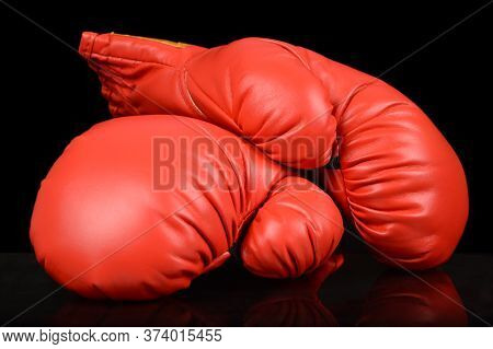 A Pair Of Red Boxing Gloves To Highlight The Competitive Sport.