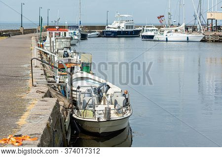 Malmo, Sweden- June 28, 2020: Small Fishing Boats In A Marina In Scania, Southern Sweden. The Fishin