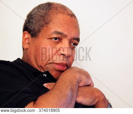 African American Male Senior Expressions Alone Indoors.