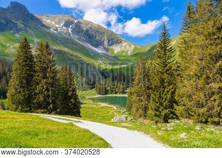 Landscape View Of Gantrischseeli At The Switzerland Nature Park, Natural Scenery With A River In The