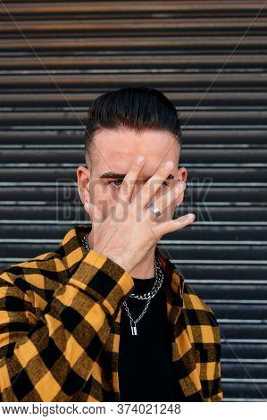 Urban Style Guy Covers His Face With His Hand. Lifestyle Concept, Conceptual Image