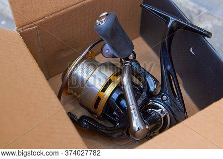 Reel For Fishing, New Reel For Fishing In A Box Of Cardboard