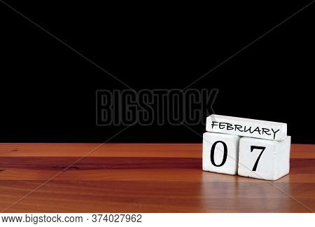 7 February Calendar Month. 7 Days Of The Month. Reflected Calendar On Wooden Floor With Black Backgr