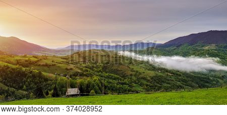 Fantastic Foggy Morning And Bright Grass In Sunlight. Carpathian, Ukraine, Europe.